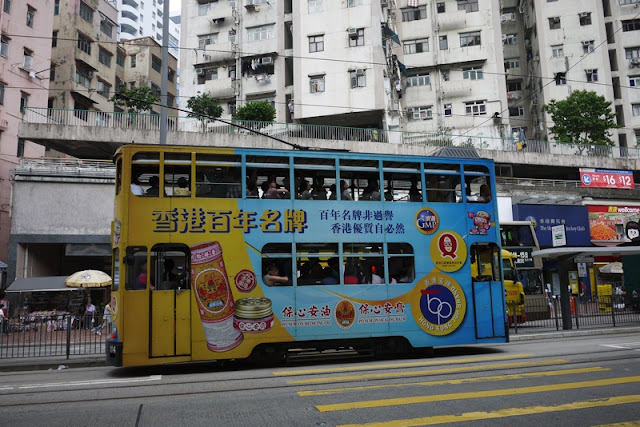 Tram in Hong Kong with Chinese traditional medicine advertising