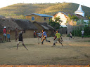 Some kids in the same village playing soccer.