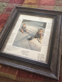Picture frame with signatures from guests on the mat.