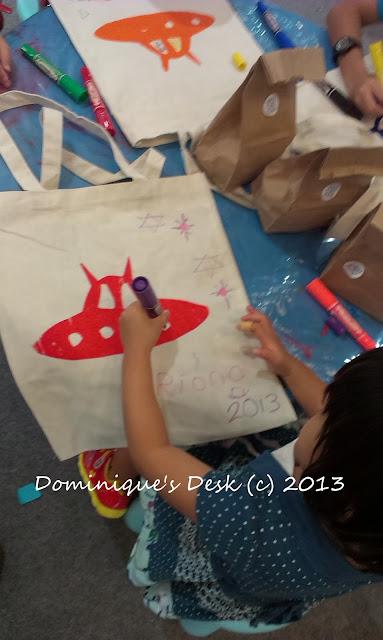 Tiger girl decorating her bag