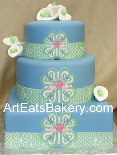 Custom blue fondant square and round green Celtic and Cladaugh design wedding cake with sugar calla lillies