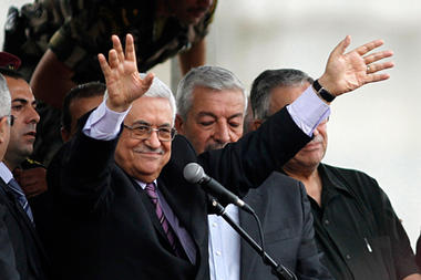 Palestinian President Mahmoud Abbas waves to the crowd during a rally in the West Bank city of Ramallah upon his return from the UN General Assembly in the US on Sunday.  Mohamad Torokman/Reuters