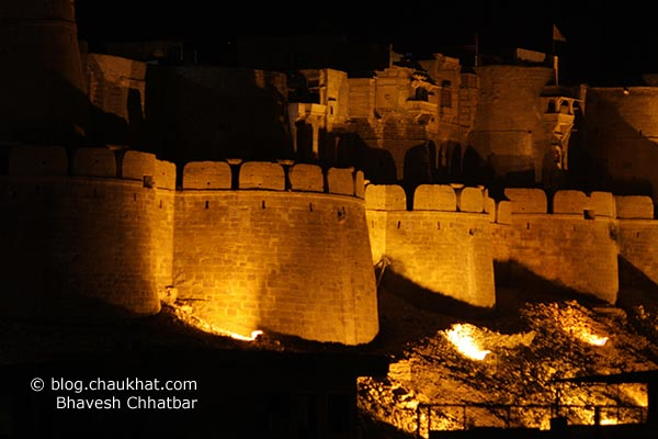Jaisalmer Fort at night. Royally ambient lights are showcasing the walls of yellow stones naturally found in Jaisalmer.