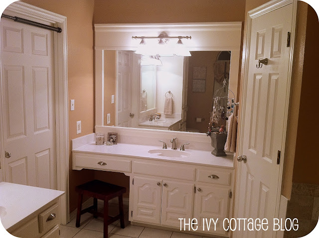 Fresh Vanity with painted cabinets new hardware new faucet and customized frame for builder us grade mirror