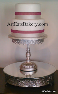 Two tier custom elegant white fondant wedding cake design with ribbon borders