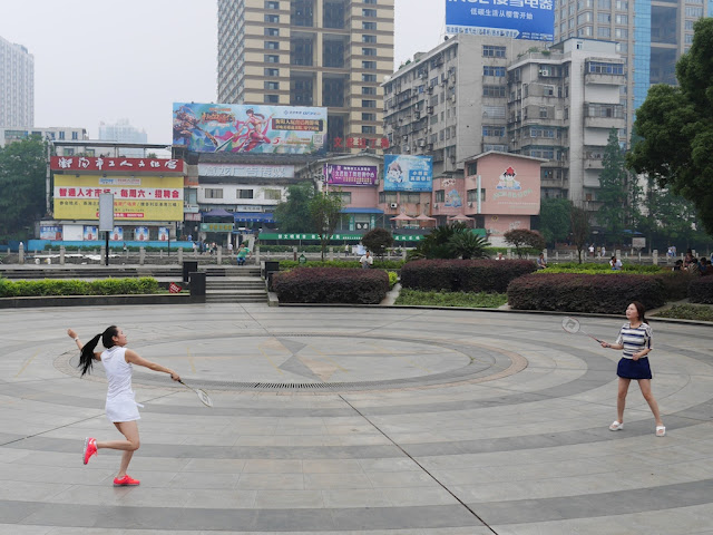 young women playing badminton