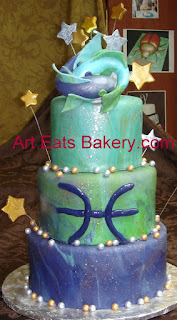 Purple, Green, blue and teal fondant three tier custom designed pisces astrological sign birthday cake with sugar fish topper