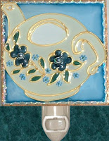cream and blue teapot with tiny blue flowers