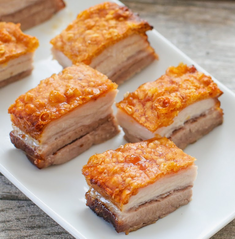 close-up photo of a slices of pork belly on a plate