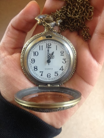 The dials of a watch pendant with a white clockface