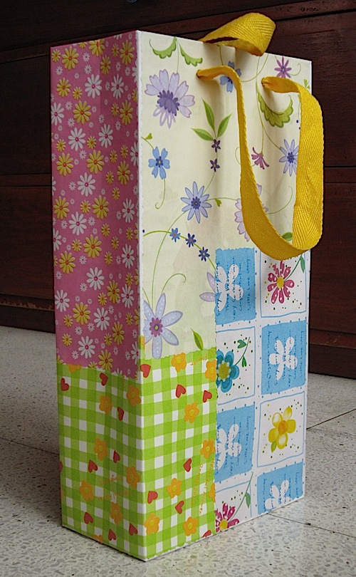 shopping bag wrapped in scrap gift paper