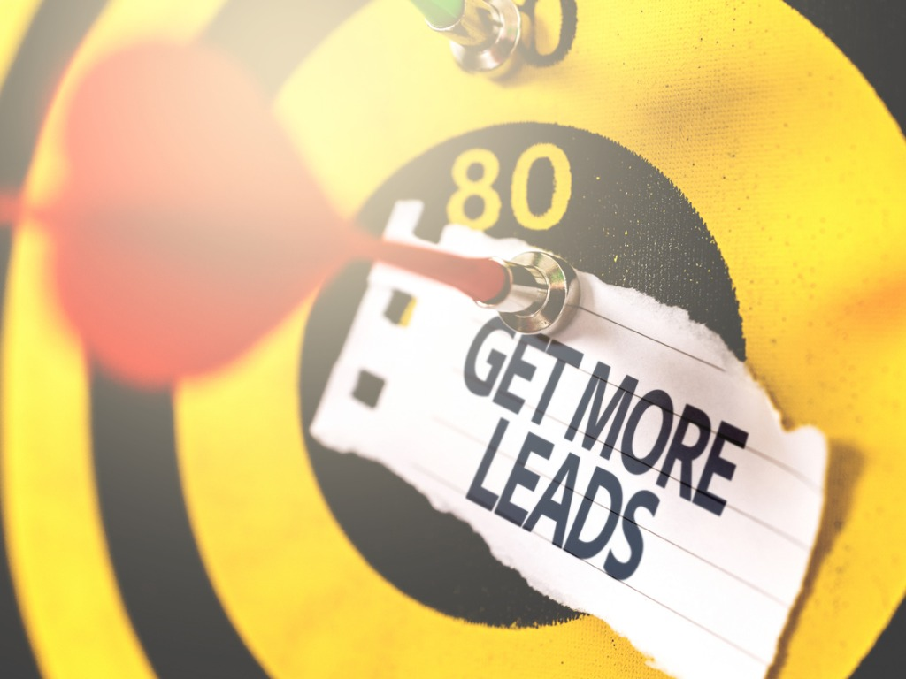 get more leads note pinned to a dart board