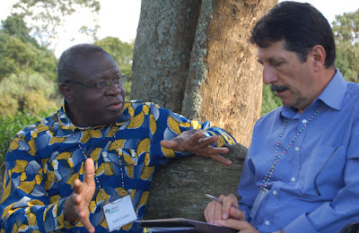 Jules Ouoba from CPE with a french colleague discussing the new network of Francophone Africa publishers at LittWorld 2012. photo by Ian Darke