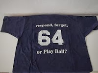 Photo of the back of a Confer % 64 t-shirt