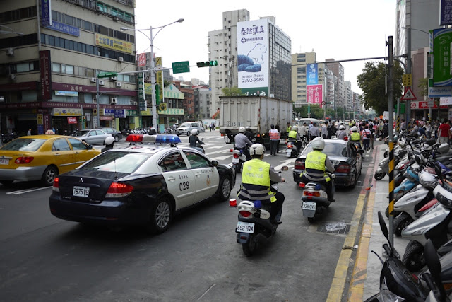 police cars and motorbikes providing traffic control and security
