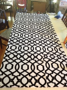 Covering a bookcase backing with black and white patterned fabric