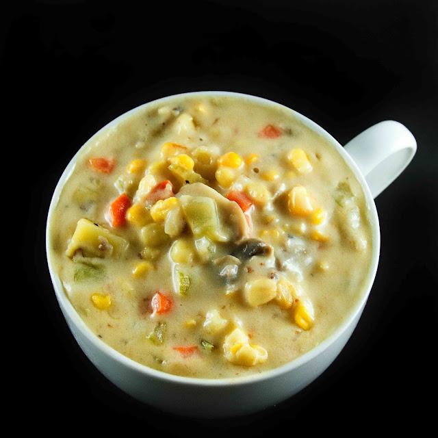 corn chowder in a large white soup mug