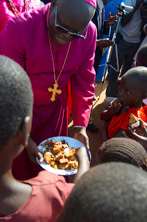 Odama serving cake to the children