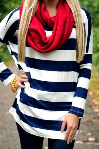 Shiny red scarf, blue and white lined blouse, black leggings and golden chain bracelet fashion for fall