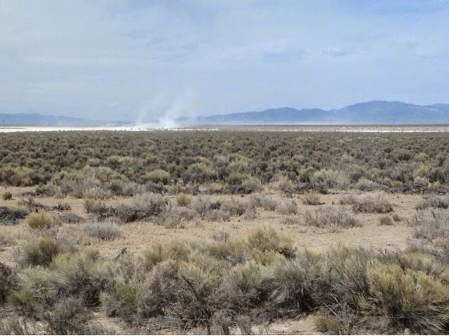 Dust devils on dry lakebed