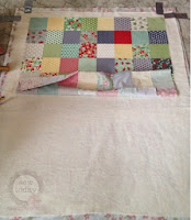 Spray, roll and smooth the quilt top