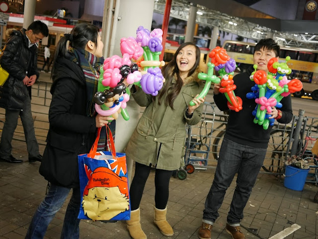 people selling balloon animals