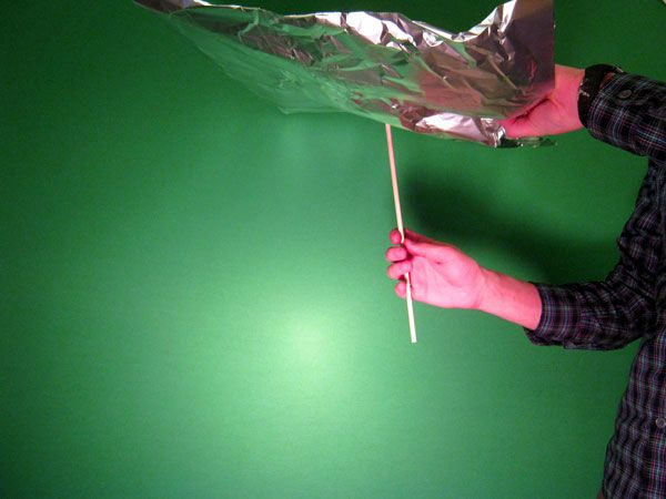 "Loosely wrap a sheet of aluminum foil around a dowel rod and tape around the ""neck"" area."