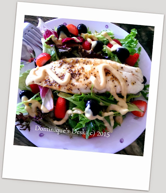Grilled fish over garden salad
