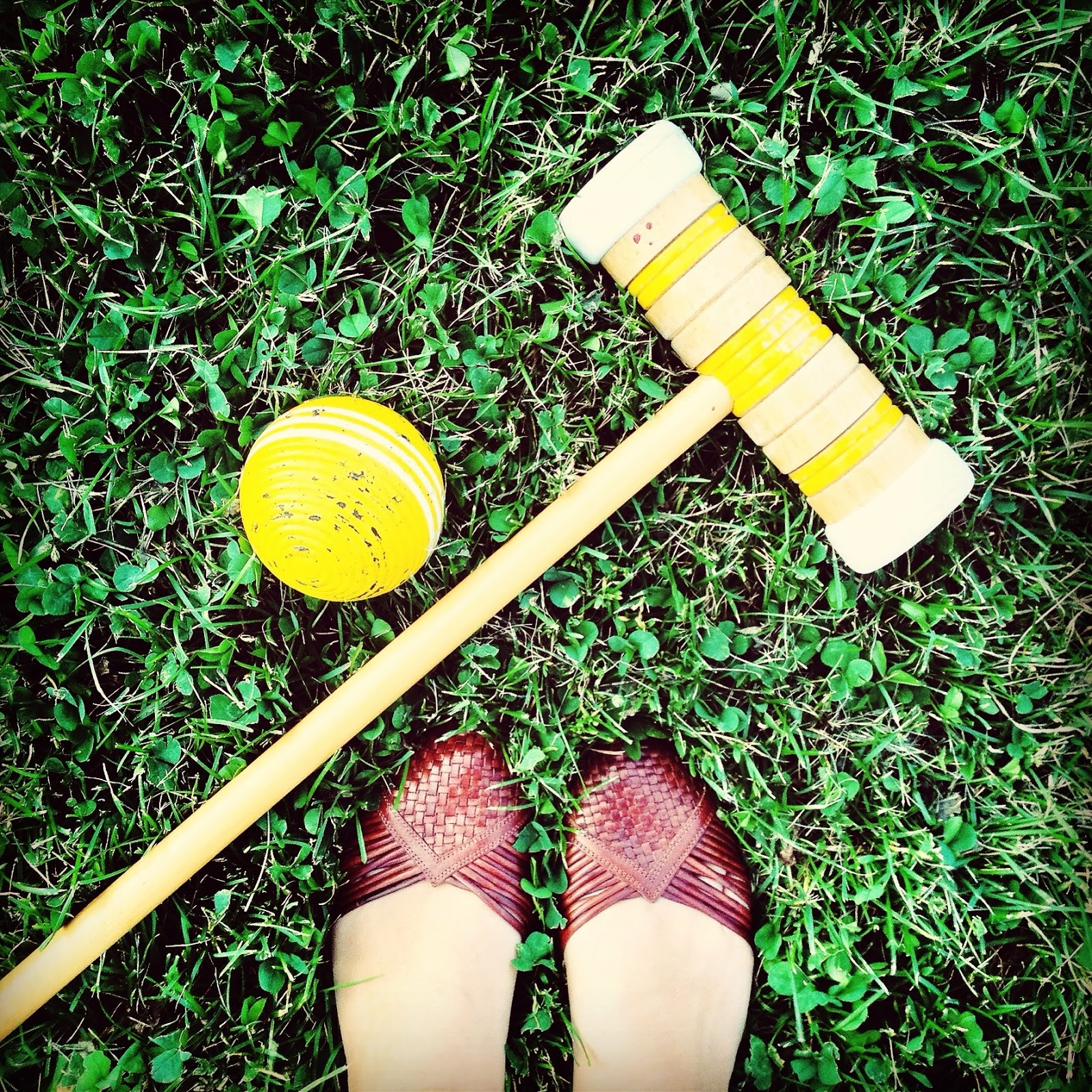 brown shoes woven croquet mallet ball