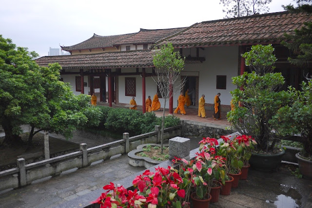 Monks in a procession at Guanghua Temple in Putian, Fujian, China