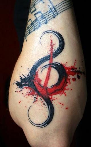 Music tattoos on elbow
