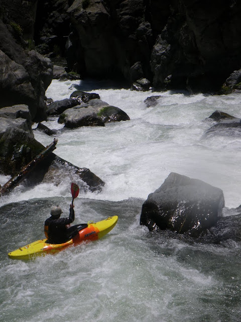 Cody Howard entering one of the countless bigger rapids on the Stash.
