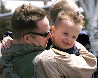 ELLSWORTH AIR FORCE BASE, S.D. -- Capt. Steve Gerken, 34th Bomb Squadron aircraft commander, and his 3-year-old son, Diedrich, embrace May 13.  Six B-1 Lancers and their crews return to a crowd of family and friends welcoming them home here.  As of May 8, B-1s flew 497 combat sorties supporting operations Enduring Freedom and Iraqi Freedom and dropped 4.56 million pounds of munitions.  (U.S. Air Force photo by Airman 1st Class Karah McNeill)