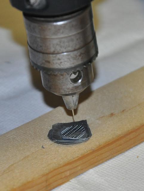 cabezal del taladro con la aguja montada