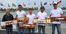 Brazilian Mauricio Santa Cruz and J/24 World Championship crew with trophies!