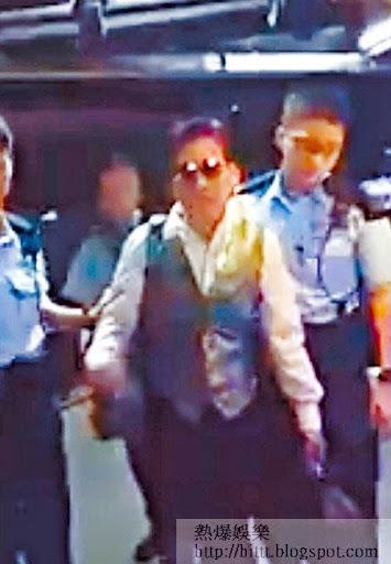 娛樂公司主席朱壽仁被指捲入非禮案,由 警員帶署助查。