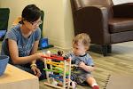 LePort Private School Irvine - Montessori daycare teacher with baby