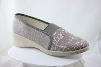 """brown squig vegan shoe as above with a 1"""" wedge heel and patterns on the mid-brown front like handwriting in white"""