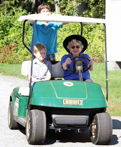 Mrs. Joanne Patton is giving the Hays grandkids a lift around the Homestead