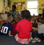 Children listen as a teacher reads aloud.