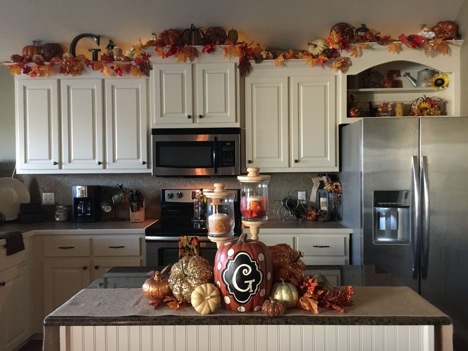 White kitchen with fall decorations.