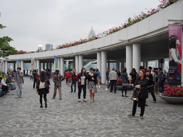 people walking at the Kowloon Public Pier