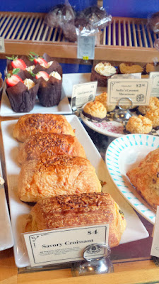 Some of the baked goods you can ogle as you approach the register of Blue Scorcher Bakery Cafe to order. Including a Savory Croissant that includes pesto, caramelized onions, cheddar cheese, asiago cheese, and egg