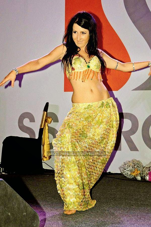 A belly dancer performs at the launch.
