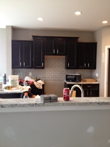 We Have A Longer Line Of Cabinets And A Stainless Steel Canopy Hood In  Place Of The Middle Cabinets. Our Cabinets Are White And Our Granite Is  Black And ...