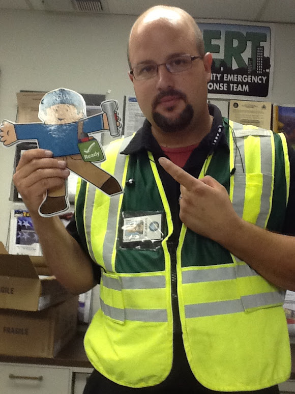 Flat Stanley with Emergency Operations Center representative.