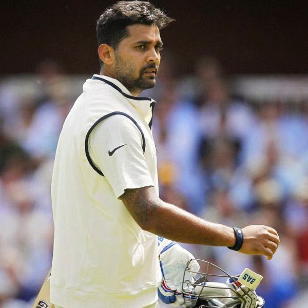 India's Murali Vijay walks back to the Pavilion after losing his wicket for 24 runs on the first day of the second cricket Test match between England and India at Lord's cricket ground in London, on July 17, 2014.