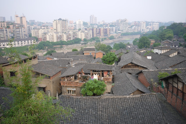 view of older homes and newer apartment buildings in Zigong, Sichuan Province