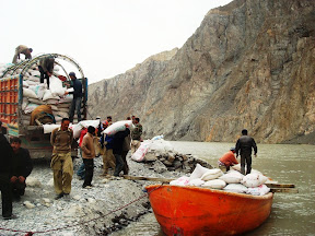 A boat is being loaded with goods brought from Sost near Hussaini Village,