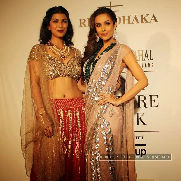 Nimrat Kaur and Malaika Arora Khan pose during the India Couture Week, 2014, held at Taj Palace, in New Delhi.
